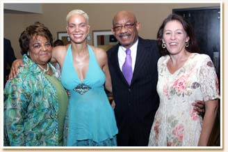 Faye and Belinda with Mr. and Ms. Herman Russell.